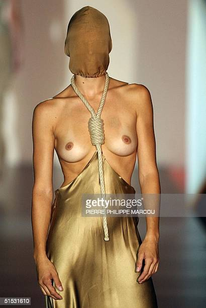 Spanish model Bimba Bose displays an outfit designed by David Delfin during the 'Pasarela Cibeles' SpringSummer Fashion Show in Madrid 13 September...