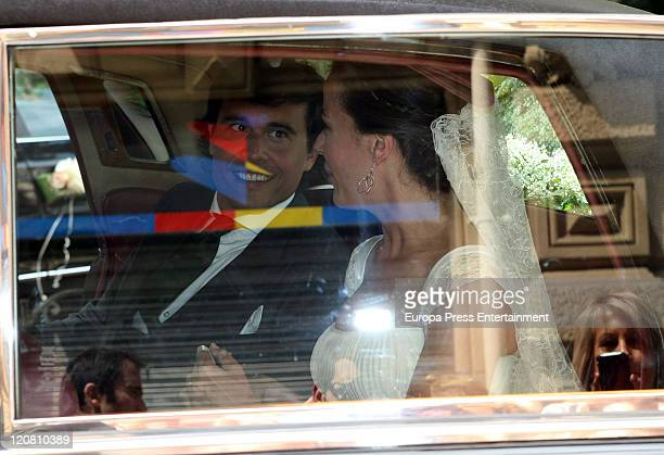 Spanish model Ines Sainz and her husband Christian Martin Perez Carrion sit in a car at their wedding at the San Vicente Abando Chapel on August 10...