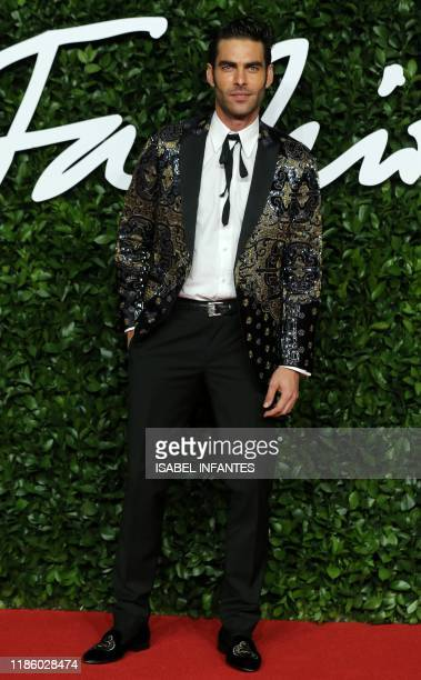 Spanish model Jon Kortajarena poses on the red carpet upon arrival at The Fashion Awards 2019 in London on December 2 2019 The Fashion Awards are an...