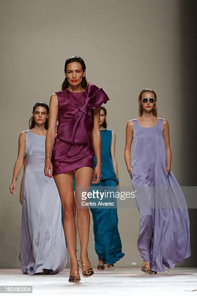 Spanish model Nieves Alvarez showcases designs by Duyos on the runway at Duyos show during Mercedes Benz Fashion Week Madrid Spring/Summer 2014 at...