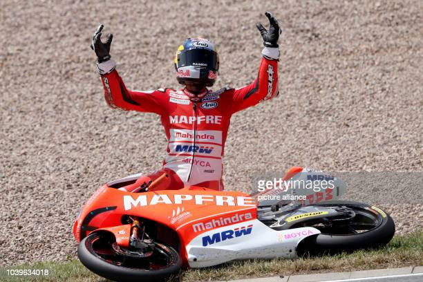 Spanish Moto GP rider Jorge Martin of MAPFRE Team MAHINDRA reacts after a fall during the qualifying at the Sachsenring racing circuit in...