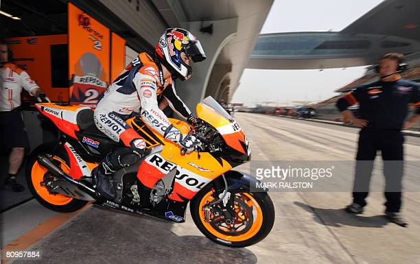 Spanish MotoGP rider Dani Pedrosa of the Honda Team leaves the pit area during the second free practice session of the Grand Prix of China at the...