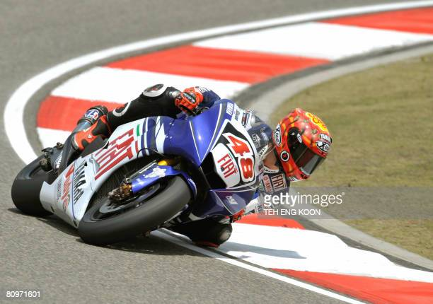 Spanish MotoGP rider Jorge Lorenzo from Fiat Yamaha Team rounds a corner during the third free practice session for the upcoming MotoGP at the...