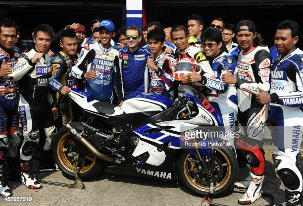 Spanish MotoGP rider Jorge Lorenzo of Yamaha Factory Racing Team poses in photo session with special guests during Yamaha ASEAN Cup Race 2013 on...