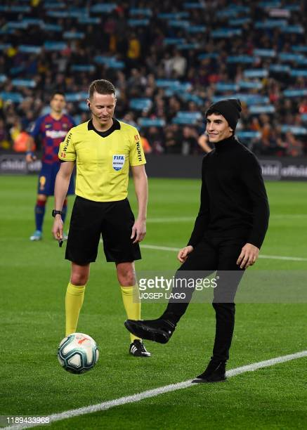 Spanish MotoGP world champion Marc Marquez kicks the ball at the start of the El Clasico Spanish League football match between Barcelona FC and Real...