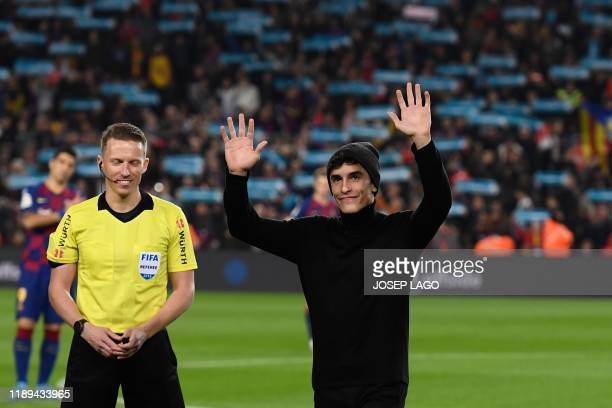 Spanish MotoGP world champion Marc Marquez waves prior to the El Clasico Spanish League football match between Barcelona FC and Real Madrid CF at the...