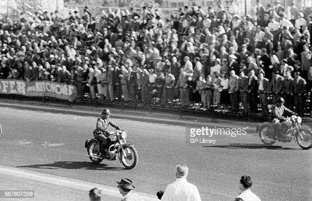 Spanish motorcycle police opening the Pedralbes boulevard circuit prerace vast crowds looking on Spanish Grand Prix Pedralbes Spain 24 Oct 1954