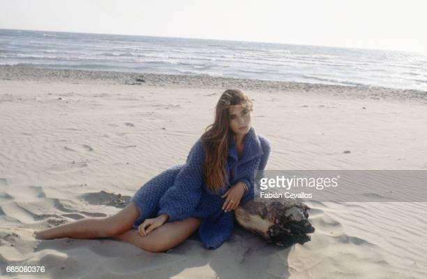 Spanish movie actress Angela Molina on a beach in Italy