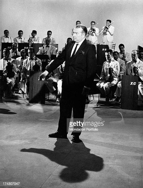 Spanish musician and conductor Xavier Cugat and his wife and American actress Abbe Lane performing with an orchestra 1950s