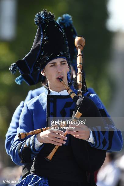 Q Spanish musicians plays bagpipe on August 6 2017 in Lorient western France during the traditional street parade of the 47th Lorient Interceltic...