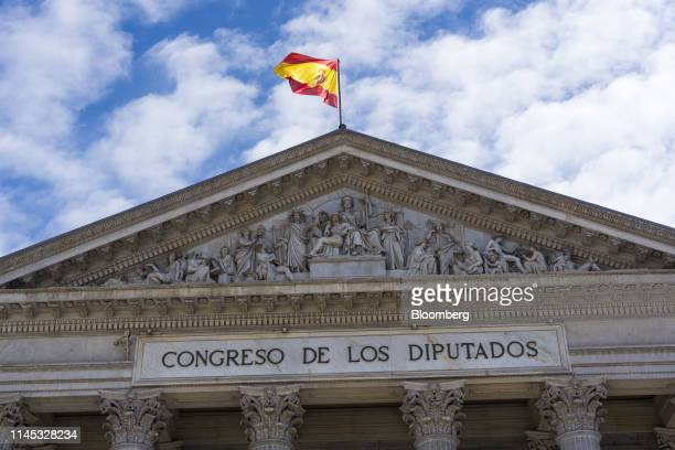 A Spanish national flag flies above the Congress of Deputies in Madrid on Tuesday May 21 2019 Five Catalan separatist leaders emerged from jail to...
