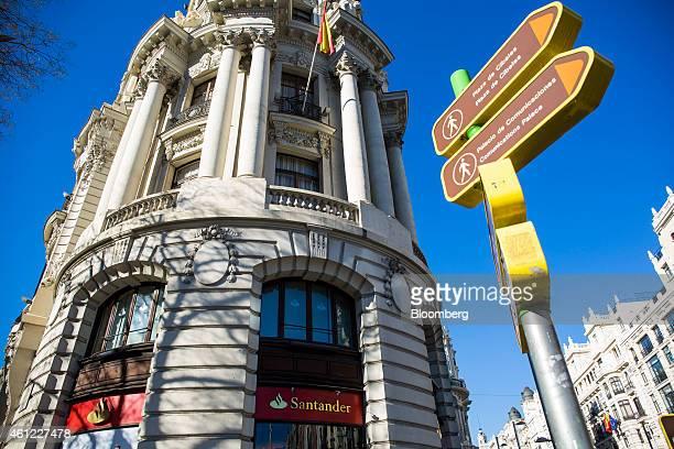 Spanish national flag hangs from the facade of a Banco Santander SA bank branch in Madrid, Spain, on Friday, Jan. 9, 2015. Banco Santander SA...