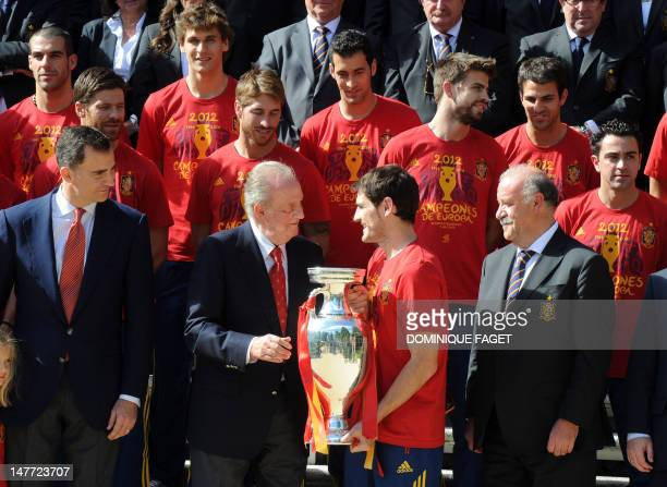 Spanish national football team goalkeeper and captain Iker Casillas and coach Vicente del Bosque show the trophy of the Euro 2012 championships to...