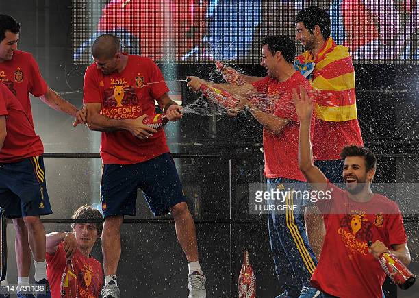 Spanish national football team players celebrate on July 2 2012 on Cibeles Square in Madrid a day after it won the final match of the Euro 2012...