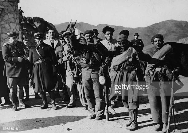 Spanish Nationalist troops fraternise with the French police at Portbou on the FrancoSpanish border 1939