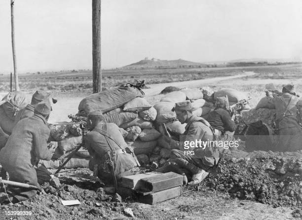 Spanish nationalist troops manning a machine gun emplacement Getafe Madrid Spain during the Spanish Civil War 9th December 1936 In the background is...