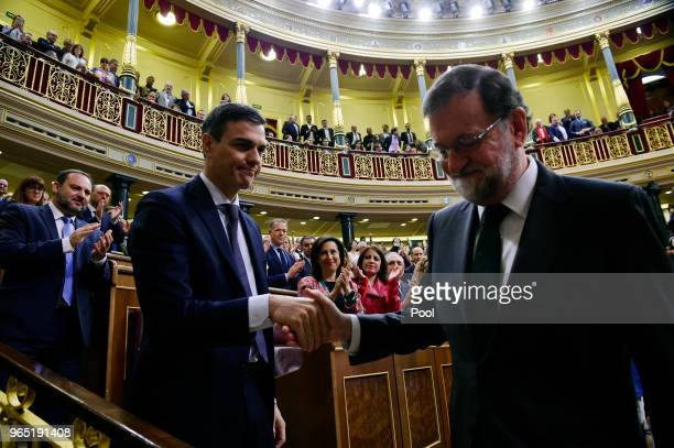 Spanish new Prime Minister Pedro Sanchez shakes hands with former Prime Minister Mariano Rajoy after Sanchez won the noconfidence motion at the Lower...