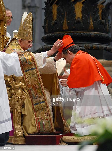 Spanish newly appointed cardinal Lluis Martinez Sistach gets his biretta square red hat symbolising the blood of the martyrs from Pope Benedict XVI...