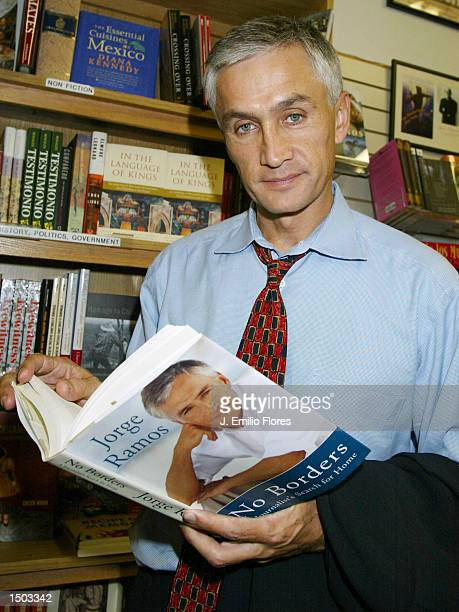 Spanish news anchor Jorge Ramos poses with his new book No Borders at a book signing October 18 2002 in Long Beach California