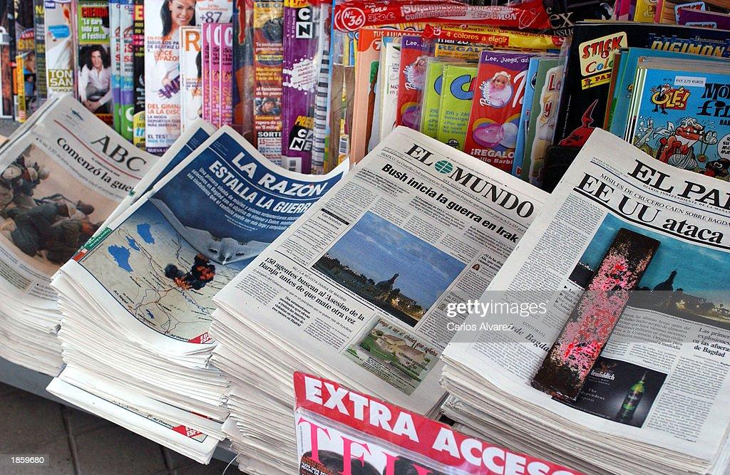 Spanish newspaper headlines report on the U S -led attack on
