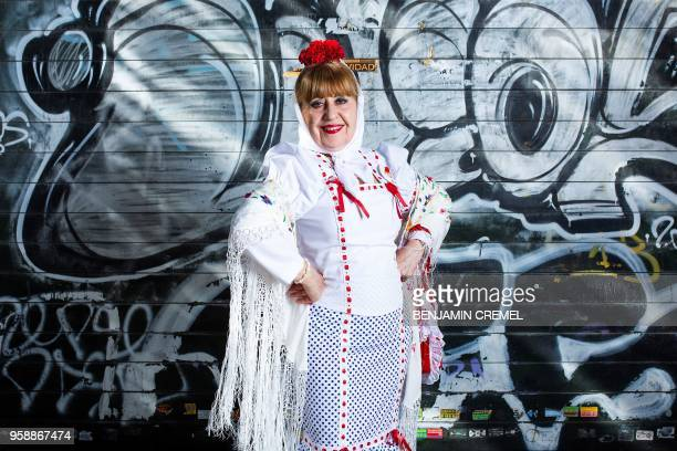 Spanish Nieves dressed in traditional chulapa garb for San Isidro celebrations poses in Madrid on May 15 2018