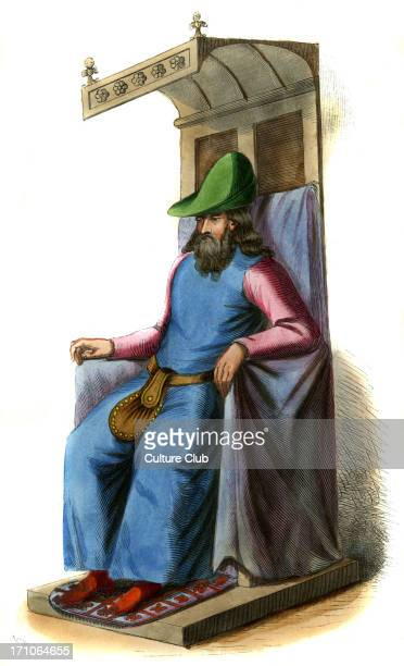 Spanish Noble male costume from 15th century shown seated on fourposter chair wearing green cap blue sleeveless coat and leather money pouch around...