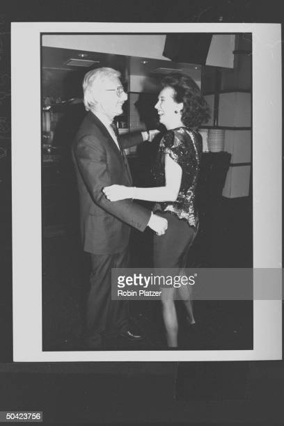 Spanish noblewoman Aline Countess of Romanones chatting w fashion designer Oleg Cassini during party at Cafe Society