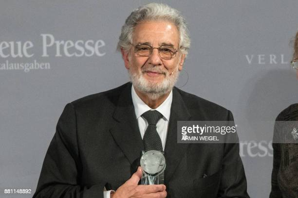 Spanish Opera singer Placido Domingo receives the People in Europe Arts Award at a ceremony in Passau southern Germany on November 28 2017 / AFP...