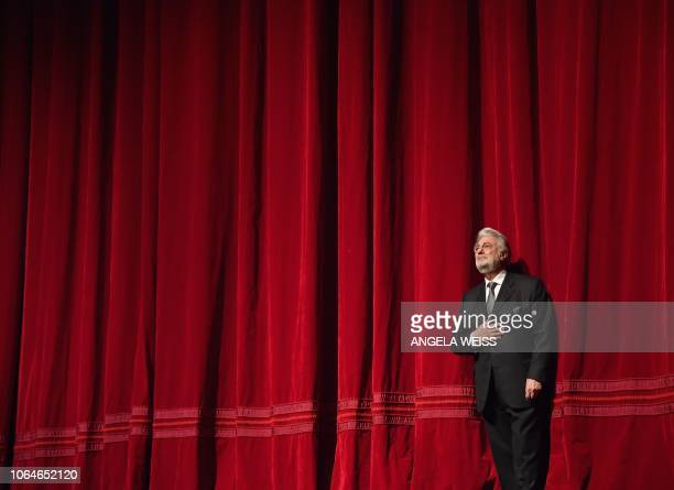 TOPSHOT Spanish opera singer Placido Domingo speaks onstage at his 50th anniversary celebration at the season premiere of Trittico at the...