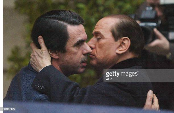 Spanish outgoing Prime minister Jose Aznar welcomes his Italian counterpart Silvio Berlusconi before taking part in the demonstration against...