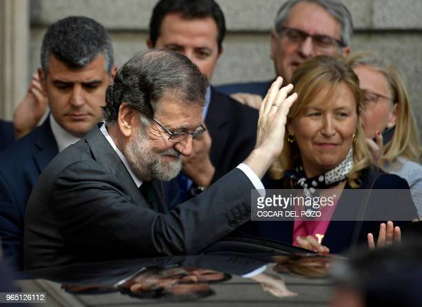 TOPSHOT Spanish outgoing Prime Minister Mariano Rajoy leaves after a vote on a noconfidence motion at the Lower House of the Spanish Parliament in...