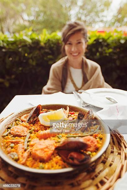 Spanish paella (pretty woman in background)