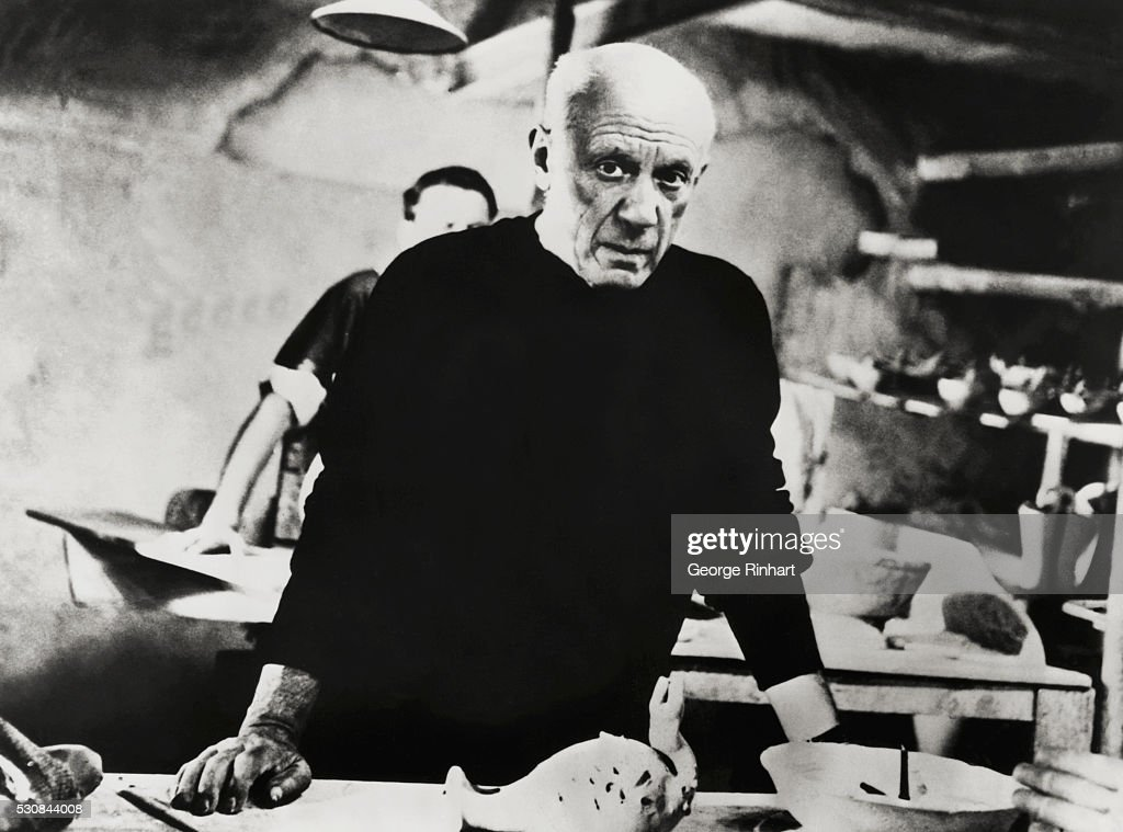 Spanish painter and sculptor Pablo Picasso, who helped develop many styles of the twentieth century at work in his studio.