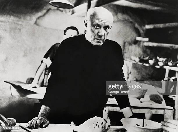 Spanish painter and sculptor Pablo Picasso who helped develop many styles of the twentieth century at work in his studio