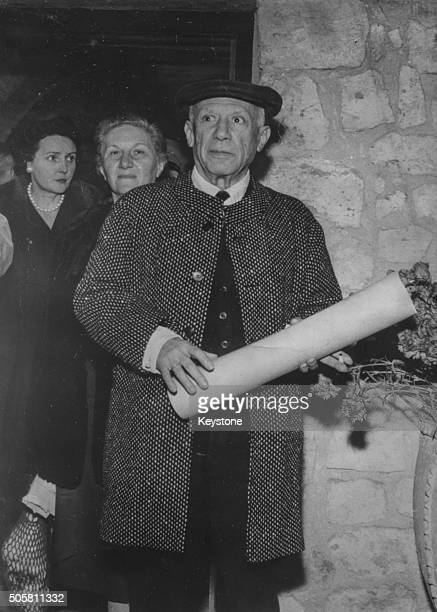 Spanish painter Pablo Picasso holding his honorary degree after being conferred the degree of citizen of honor of Antibes at Grimaldi Museum France...