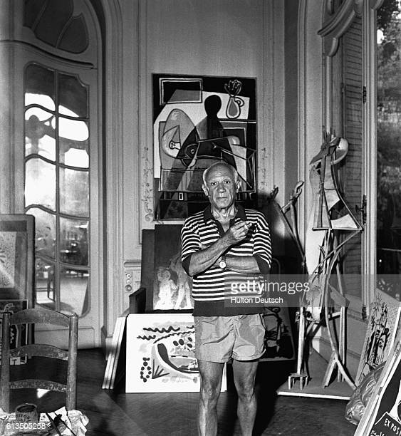 Spanish painter Pablo Piccasso surrounded by artworks at his villa La Californie in Cannes in 1955
