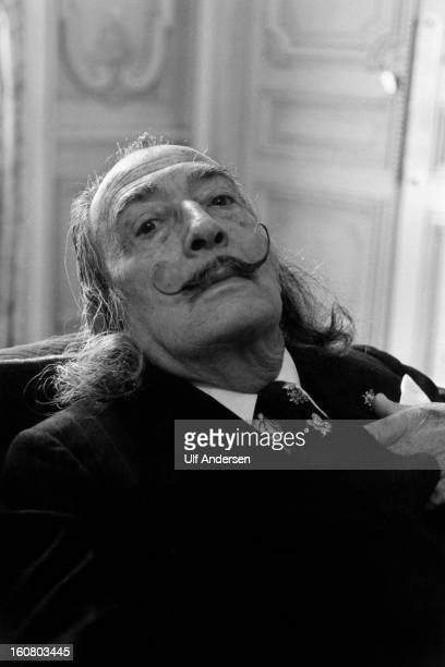 Spanish painter Salvador Dali poses during a portrait session held at Hotel Meurice in 1973 Paris France