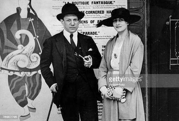 Spanish painter sculptor and artist Pablo Picasso posed with Russian ballet dancer Olga Khokhlova at the opening of the ballet 'Parade' featuring...