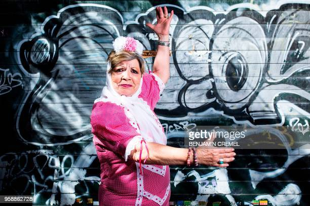 Spanish Paquita dressed in traditional chulapa garb for San Isidro celebrations poses in Madrid on May 15 2018