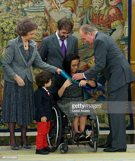 Spanish Paralympic medalist Teresa Perales with her husband Mariano Menor and his son Mariano Menor Jr receives from King Juan Carlos of Spain and...