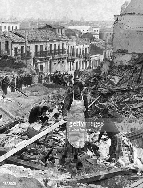 Spanish people search through the rubble in Madrid where their homes once were during the Spanish Civil War