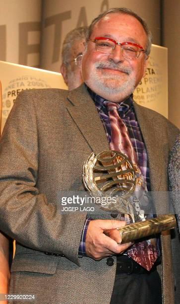 "Spanish philosopher Fernando Savater poses after winning the Planeta literature award for his book ""La hermandad de la buena suerte"" in Barcelona, on..."