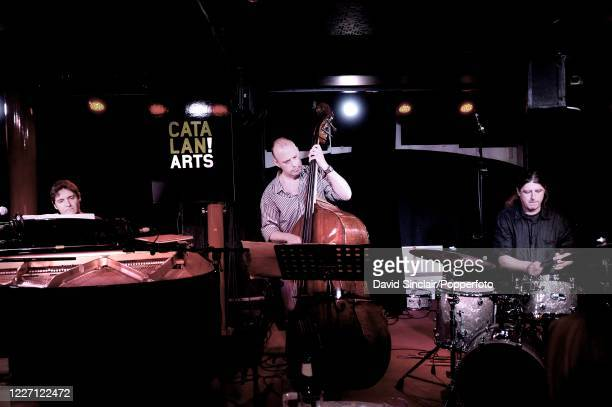 Spanish pianist Xavier Dotras performs live on stage with his trio drummer Cesar Martinez and double bassist Toni Pujol at PizzaExpress Jazz Club in...