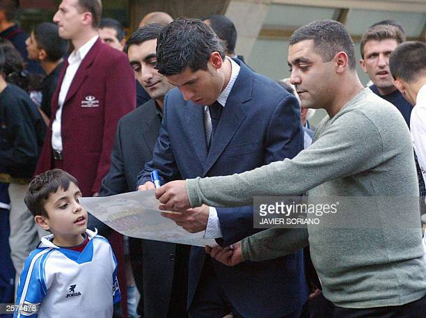 Spanish player Albert Luque signs autographs for supporters upon his arrival at Yerevan airport 09 October ahead of Spain's Euro 2004 classification...