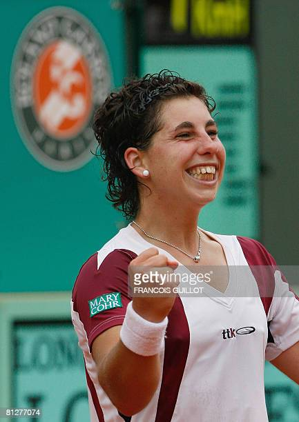 Spanish player Carla Suarez Navarro celebrates after defeating her French opponent Amelie Mauresmo during their French tennis Open second round match...