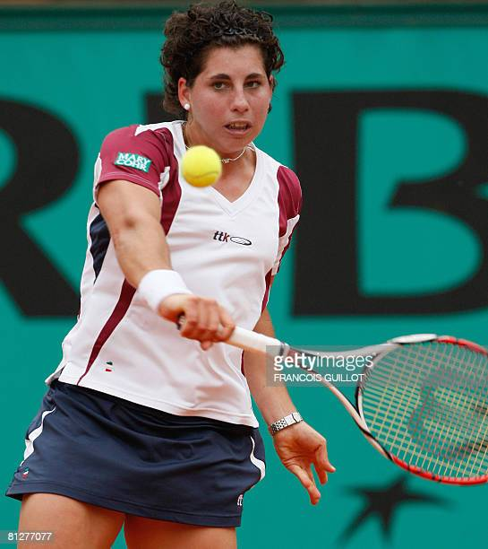 Spanish player Carla Suarez Navarro hits a return to her French opponent Amelie Mauresmo during their French tennis Open second round match at Roland...