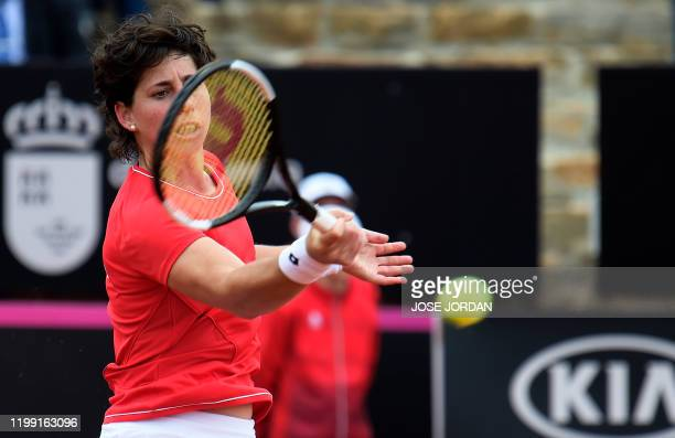 Spanish player Carla Suarez returns the ball to Japanese player Misaki Doi during their Fed Cup Qualifiers first round tennis match between Spain and...