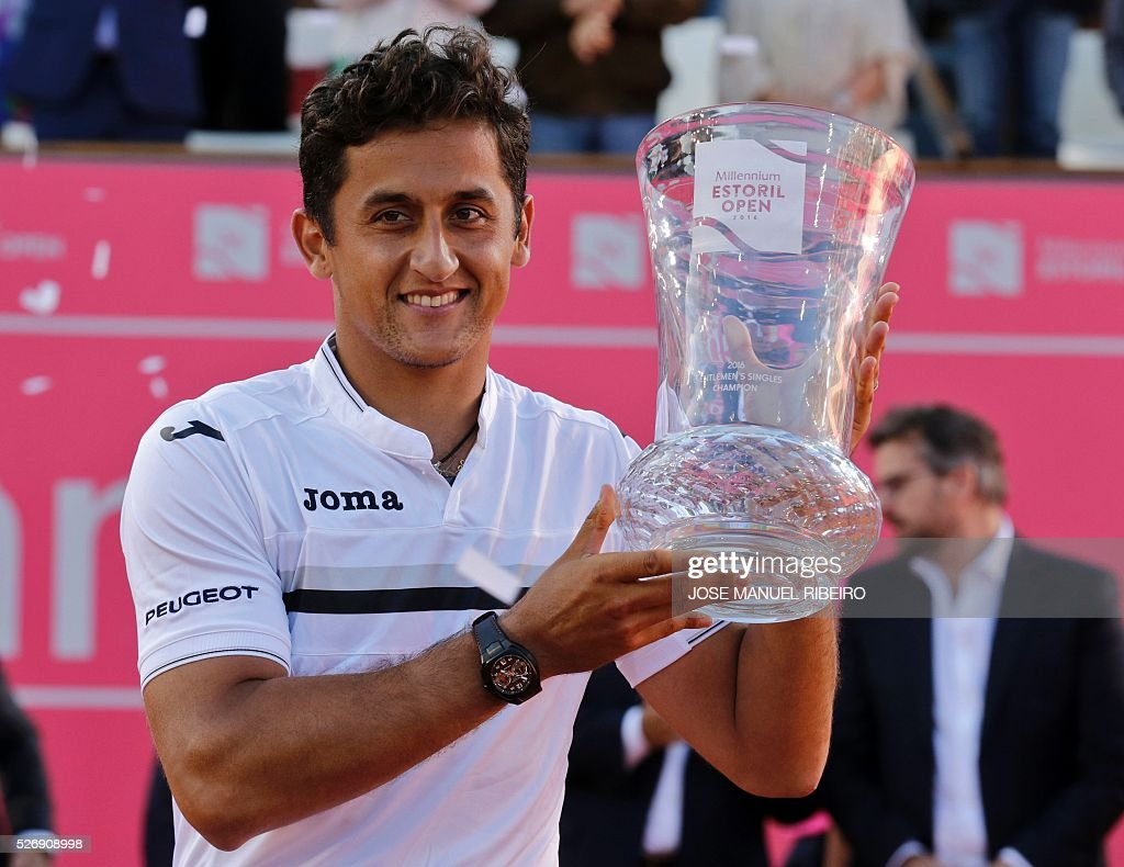 Spanish player Nicolas Almagro poses with his trophy after his victory over his compatriot Pablo Carreno Busta during the Estoril Open Tennis tournament in Estoril on May 1, 2016. Almagro won 6-7, 7-6 and 6-3. / AFP / JOSE