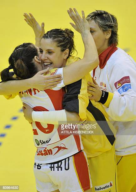 Spanish player of this match goalkeeper Cristina Gonzales celebrates their victory with teammate Macarena Aguilar and Micaela Ciobanu against Romania...