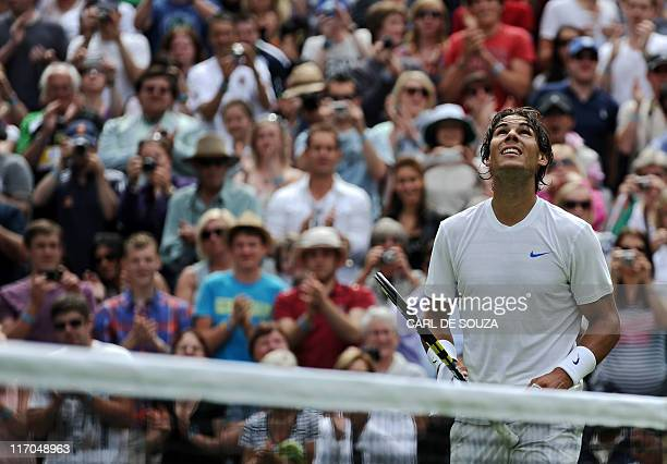 Spanish player Rafael Nadal celebrates after beating Michael Russell of US 6-4, 6-2, 6-2, during a Men's Singles match at the 2011 Wimbledon Tennis...